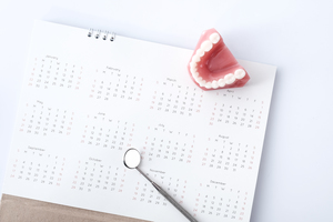 Calendar with dental instrument and denture
